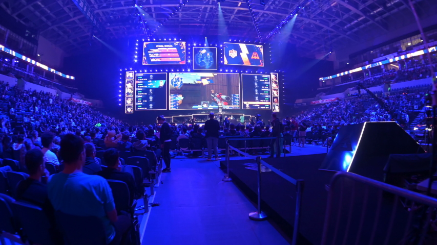 MOSCOW, RUSSIA - 14th SEPTEMBER 2019: esports Counter-Strike: Global Offensive event. Overview stabilized shot of arena, player's booths, big screens and tribunes.
