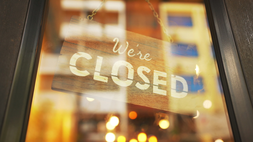 Business owner turning as open (Aberto in portuguese) for business sign in their storefront window   Shutterstock HD Video #1038502148