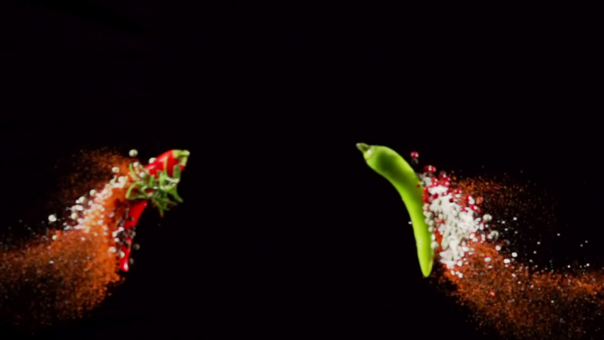 Exotic Spices paprika variation salt and peppercorn collide on black background closeup in super slow motion