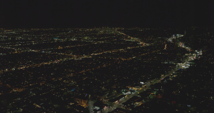 Aerial shot, night, Los Angeles, neighborhoods with business buildings in background, drone   Shutterstock HD Video #1038529214