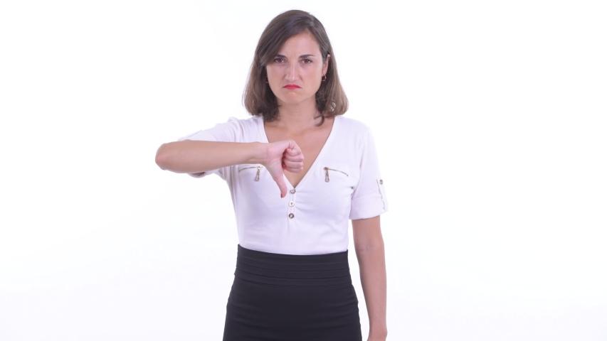Sad businesswoman giving thumbs down   Shutterstock HD Video #1038533525