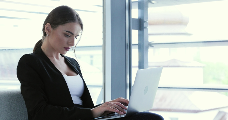 Business woman working on computer at office center. Beautiful female with laptop at workplace | Shutterstock HD Video #1038540593