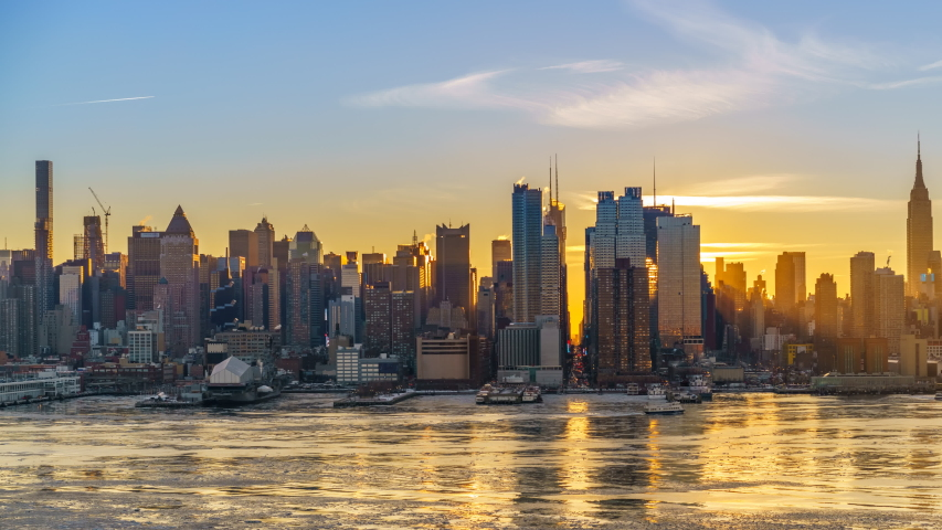 Midtown Manhattan skyline at sunrise in New York, timelapse of rising sun | Shutterstock HD Video #1038546041