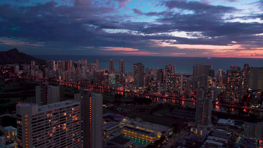 Aerial view of Ala Wai Canal an artificial waterway in Waikiki. Honolulu skyline in the background. Modern hotels, resorts and buildings. Oahu, Hawaii. Unites States. Dusk.