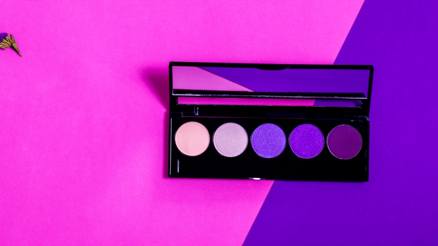 Animated opening of makeup eyeshadow palette with limonium flowers on the colorful background. Make-up eyeshadow palette set.   Shutterstock HD Video #1038549794