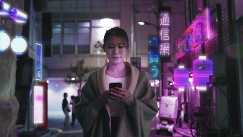 Japanese woman in future Augmented Reality Tokyo city looks at her phone with holographic ads in the background that read: Phone, Telecom, High tech, Buy Now, Network, Security, and Free to try.