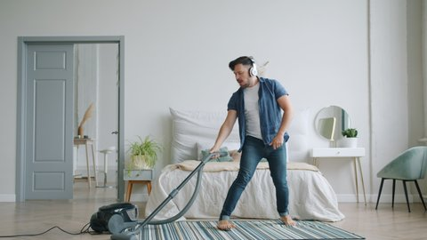 Attractive Young Man Is Vacuuming Stock Footage Video 100 Royalty Free 1038577265 Shutterstock