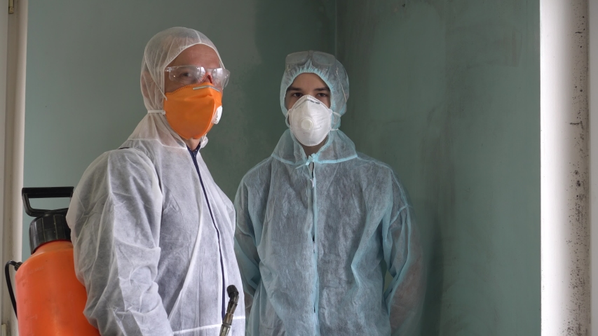 Control of Coronavirus epidemic- and pandemic-prone acute respiratory diseases. Cleaning and Disinfection. Infection prevention and control of epidemic. Protective suit and mask Royalty-Free Stock Footage #1038589166
