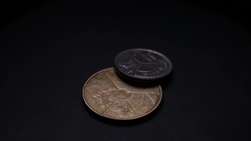 Close Up Of Belgium Coins Rotating On Black Background. | Shutterstock HD Video #1038590804