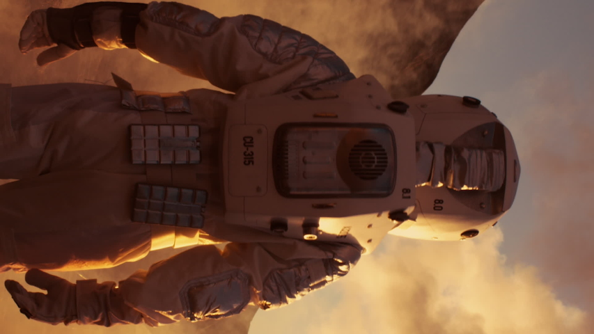 Astronaut on Mars Walking on the Exploring Expedition. In the Background His Base/ Research Station. First Manned Mission To Mars. Video Footage with Vertical Screen Orientation 9:16   Shutterstock HD Video #1038600335