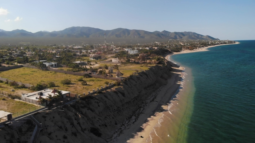 An aerial view of La Ventana, a quiet coastal town outside of La Paz on the Baja California coast of Mexico along the Gulf of California with a view of Isla Ceralvo island.