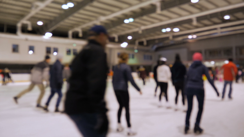 People ice skating. Ice skating rink. Defocused | Shutterstock HD Video #1038646349