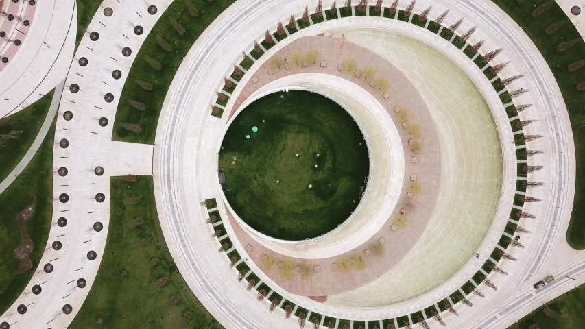 Aerial drone flight over beautiful park with geometric circle garden, looks like moon. Krasnodar, Russia, 4k. geometric tracks full of young trees, march 2018 | Shutterstock HD Video #1038651227
