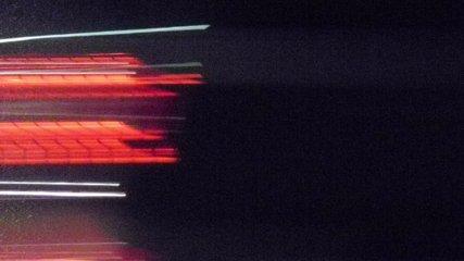Super fast cars lights. Night motion time lapse. Hyper speed - urban movement loop. Minimal background texture. Modern cityscape - blurred night street road traffic.