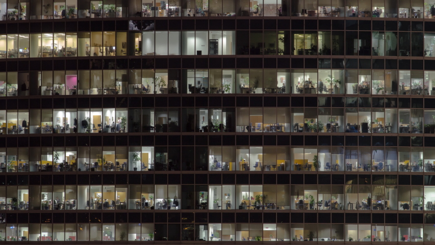 Close view to office windows in Skyscrapers International Business Center City at night timelapse from top, Moscow, Russia. Tilt up | Shutterstock HD Video #1038665594