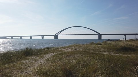 Fehmarn sound bridge with beach and rushing waves, 4k video