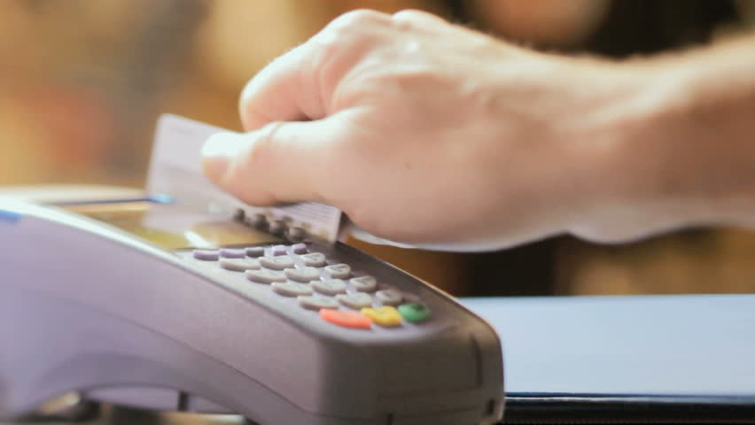 Credit card sale transaction, swiping card through terminal machine  | Shutterstock HD Video #10386686