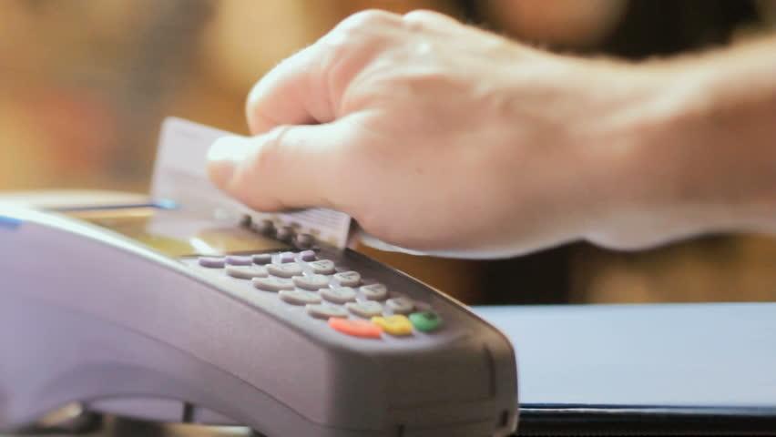 Credit card sale transaction, swiping card through terminal machine  #10386686