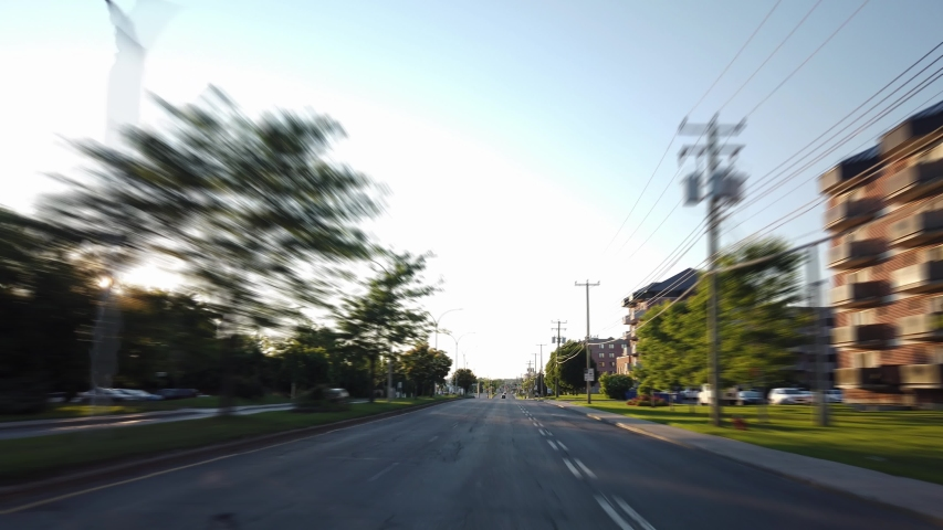 MONTREAL, CANADA - JULY 2019: Hyperlapse driving on boulevard saint-jean during a sunny summer day | Shutterstock HD Video #1038680921