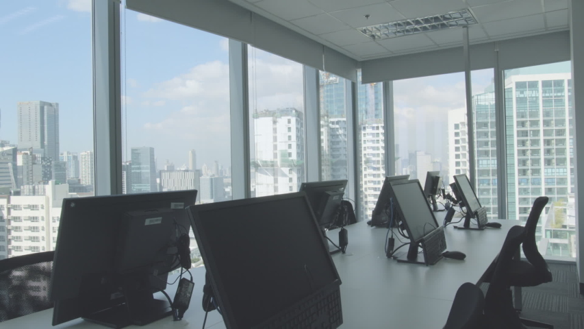 Fresh And Modern Corporate Office Space - Desk And Chairs Window Side | Shutterstock HD Video #1038725699