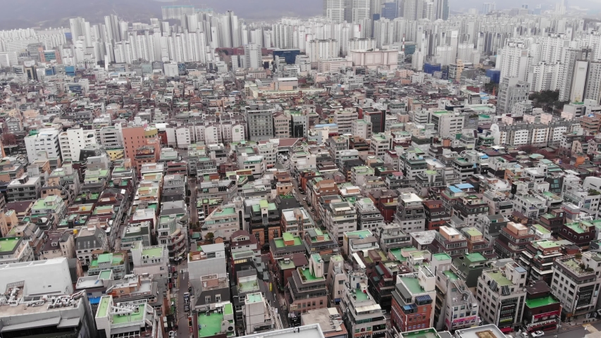 Daechi-dong residential area of Gangnam, aerial shot. Low-rise house buildings, expensive real estate at central district of Seoul city. Camera fly forward and tilt down Royalty-Free Stock Footage #1038733778