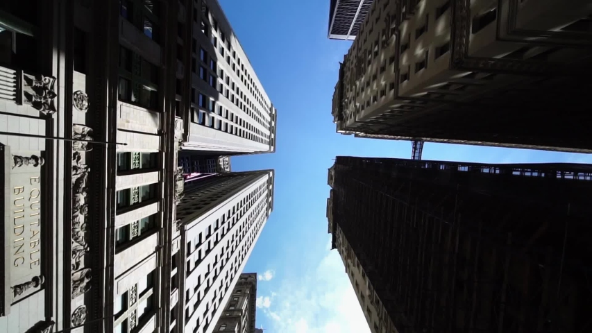 Moving looking up pov drone shot of NYC New York City Manhattan modern skyscraper high-rises. Concept of financial center, modern business city, historic iconic travel destination in USA.   Shutterstock HD Video #1038757181