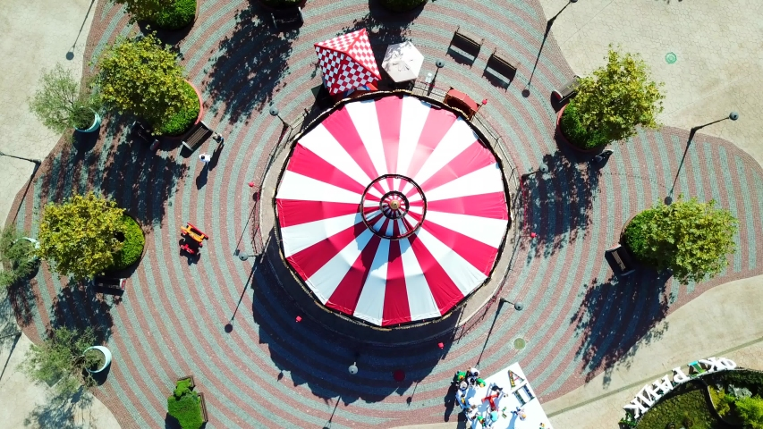 Aerial view of red and white spinning carousel at Moscow