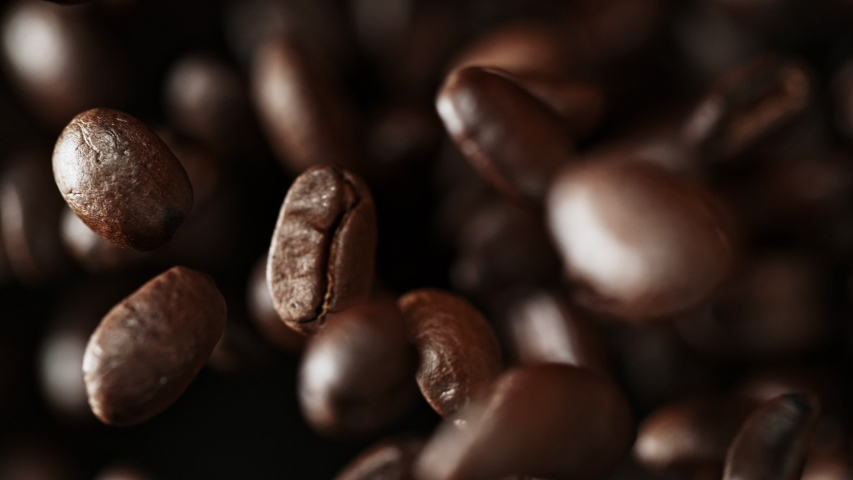 Super Slow Motion Shot of Exploding Premium Coffee Beans Towards the Camera at 1000fps. #1038788111