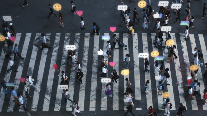 High Angle Shot of a Crowded Pedestrian Crossing in Big City. Augmented Reality of Social Media Signs, Symbols, Location Tracking and Emojis are Added to People. Future Technology Concept.