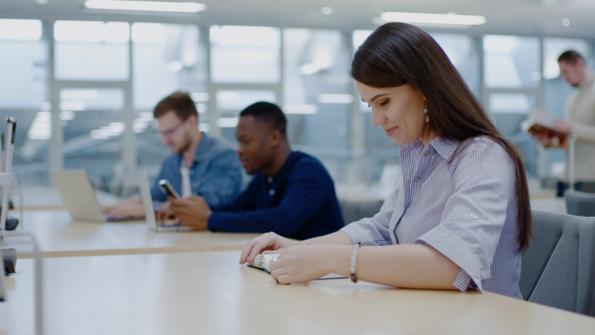 Multicultural group of students studying in a public library   Shutterstock HD Video #1038802604