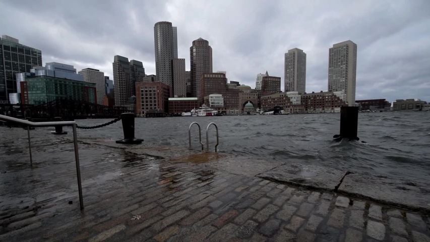 Winds and waves crash along Boston's waterfront during a strong winter storm