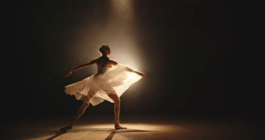 Cool female ballet dancer showing an artpiece on stage, doing different moves - arts, way to success concept 4k footage