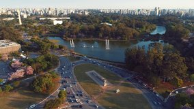 Aerial view of sunset at Ibirapuera's Park and Flag's Monument, Sao Paulo, Brazil. Great landscape. Cityscape's scenery. Sunset's scene. Ibirapiera Park, São Paulo. Leisure scene. Lake and square view