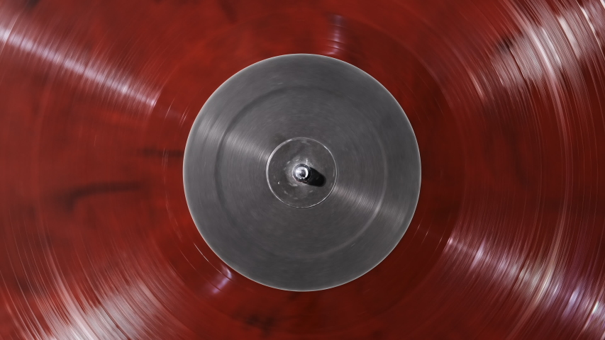 Vinyl Red Retro background grey screen in center. Vinyl record DJ turntable record player close up. Rotating plate and stylus needle close-up. Loop. Macro.Popular Disco Trends 70s, 80s, 90s