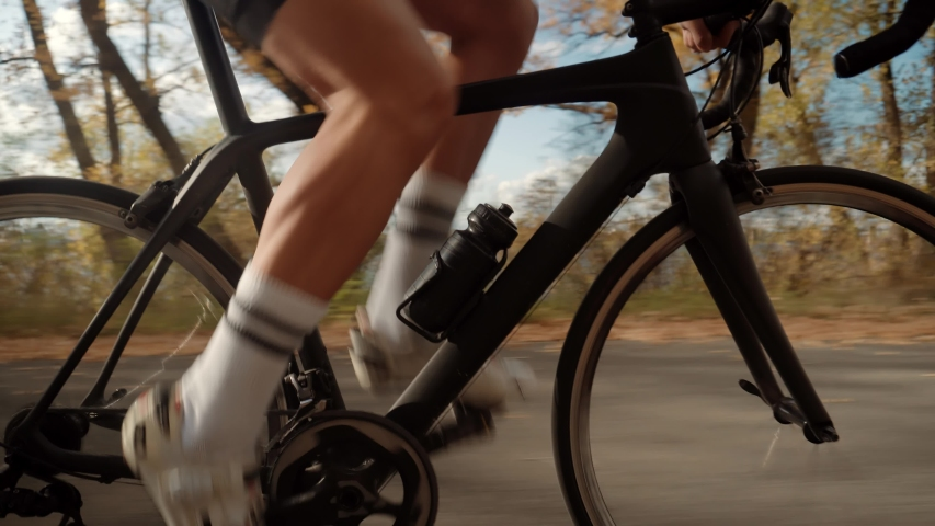 Cyclist Legs Triathlete Pedaling And Exercising Before Triathlon.Cyclist Twists Pedals And Riding On Bicycle.Cycling Athlete Cardio Endurance Workout.Gear System And Bike Wheel Rotation.Sport Concept | Shutterstock HD Video #1038905480