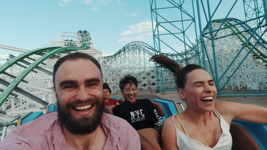 Los Angeles, California/USA - 08.24.2019: Roller coasters at Six Flags in California, selfie video of riders, lots of fun and adrenalin, extreme riding, laughing and screaming of excitement