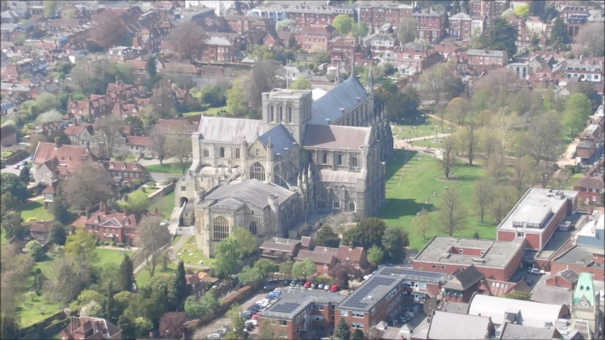 Winchester City from an aerial perspective. Really zoomed in on Cathedral | Shutterstock HD Video #1038934358
