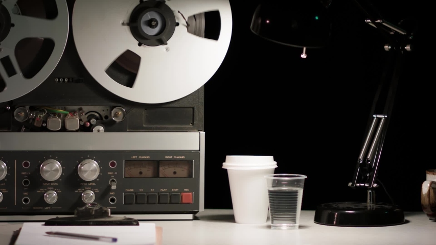 Retro Analog Quarter-Inch Tape Recorder Being Operated in a Darkened Room | Shutterstock HD Video #1038952163