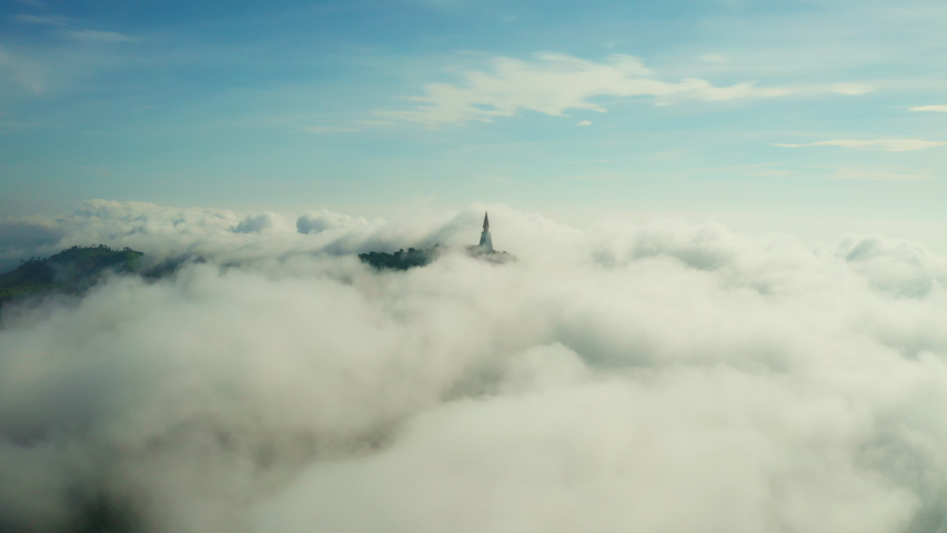 Beautiful fuzzy cloudy in skyscape with antique Buddhism stupa on mountain peak. Aerial view from drone. Flying is panorama curve. | Shutterstock HD Video #1038963596