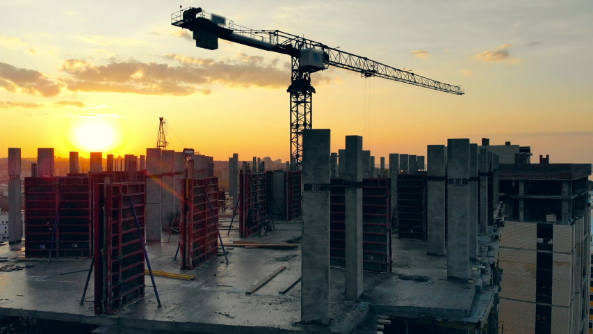 Urban construction site with cranes at sunset | Shutterstock HD Video #1038971078