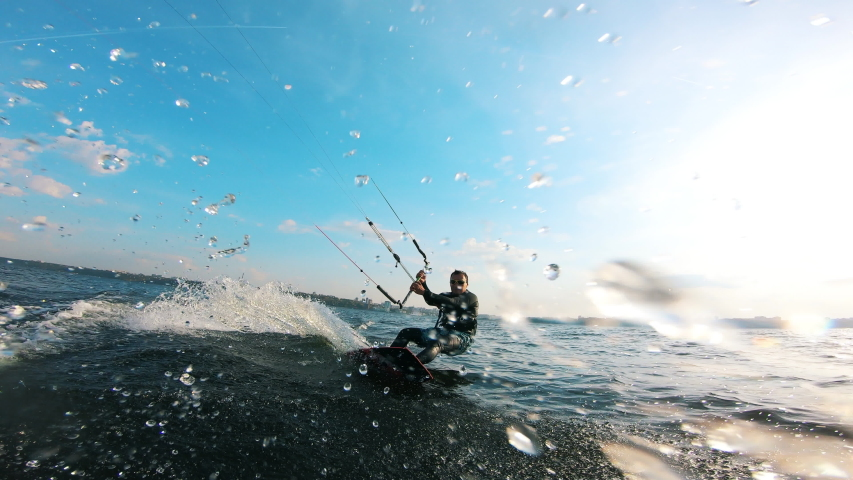 One sportsman training on surfing board with kite. #1038971438