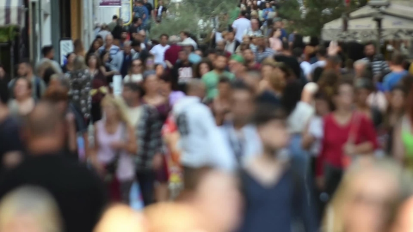Crowd of people walking in a busy street of town Royalty-Free Stock Footage #1038996725