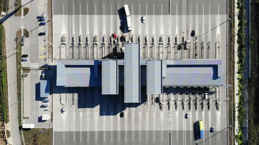 Cars passing a modern large highway toll booth, aerial view | Shutterstock HD Video #1038997250