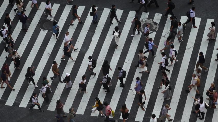 Tokyo,Japan -  September 26, 2019:Pedestrians people crosswalk around Shibuya district area in Tokyo, Japan   Shutterstock HD Video #1038997589