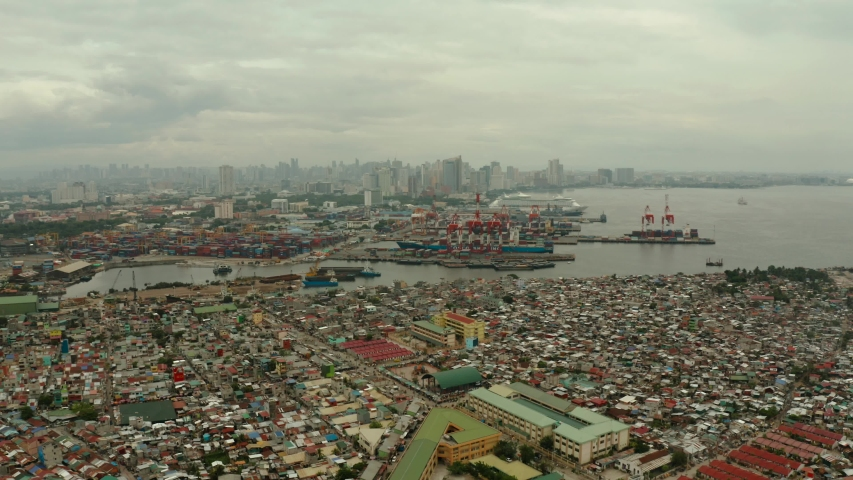 Trading port in Manila. Cargo cranes and containers in the port. Landscape.