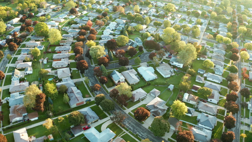 Aerial view of residential houses at autumn (october). American neighborhood, suburb. Real estate, drone shots, sunset, sunny morning,  sunlight, from above   Shutterstock HD Video #1039007924