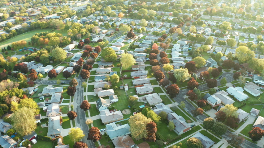 Aerial view of residential houses at autumn (october). American neighborhood, suburb. Real estate, drone shots, sunset, sunny morning,  sunlight, from above