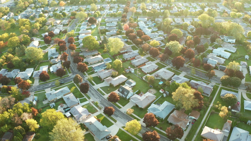 Aerial view of residential houses at autumn (october). American neighborhood, suburb. Real estate, drone shots, sunset, sunny morning,  sunlight, from above   Shutterstock HD Video #1039007930