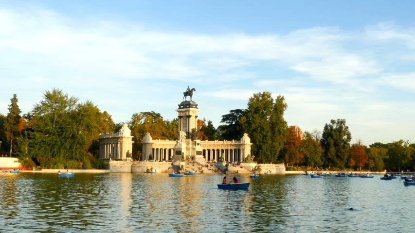 Buen Retiro Park Lake Tourists enjoying boats in Madrid Spain footage | Shutterstock HD Video #1039012055