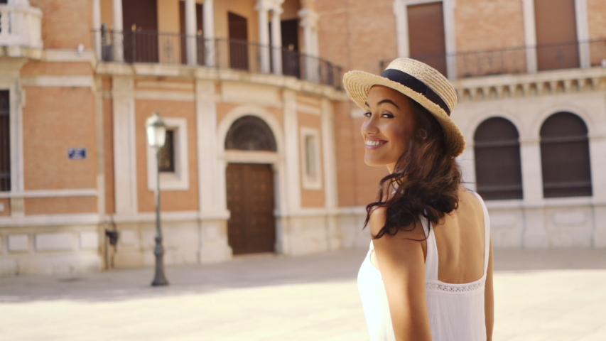 Young fashion girl exploring old city of Valencia in the morning at a sunny day   Shutterstock HD Video #1039016720
